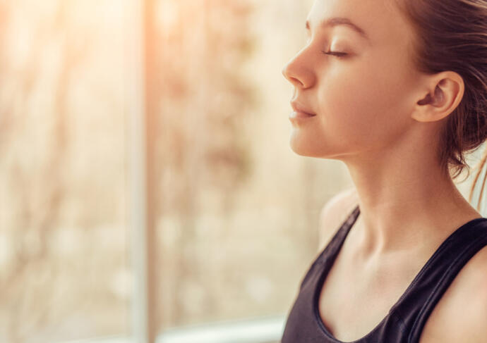 Woman practicing mindful breathing