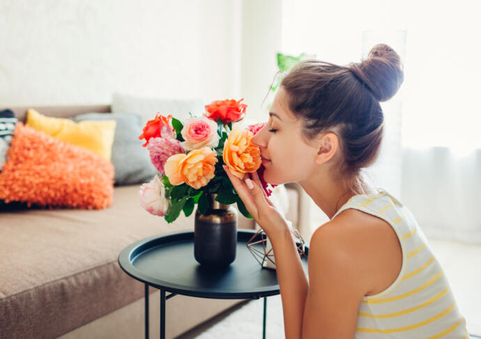 Woman smelling fresh flowers