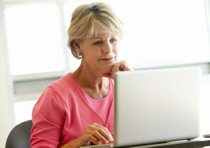 Older woman using computer