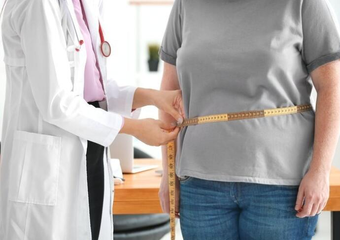Provider measuring patients waist