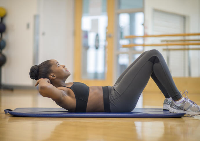 Woman doing crunches six pack abs