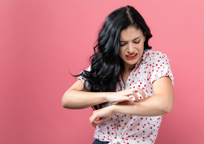 Woman Itching Arm Getty Images 1044939258