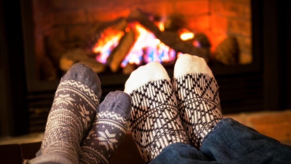 176623353 Feet Warming By Fireplace
