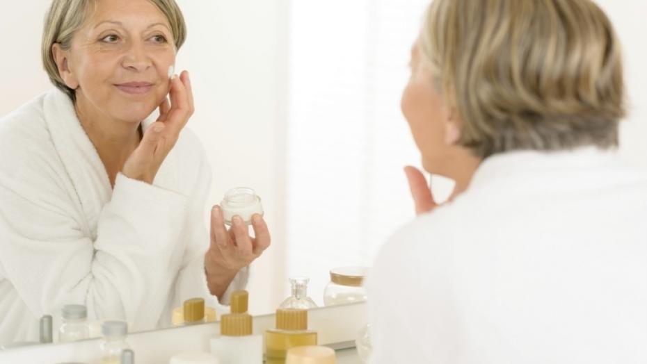 177360536 Woman Looking In Bathroom Mirror