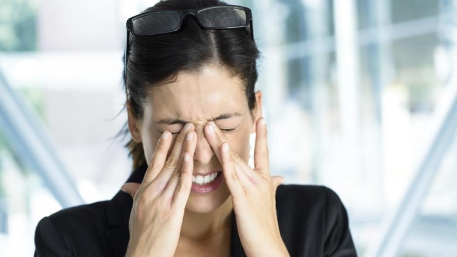184016607 Woman Rubbing Eyes