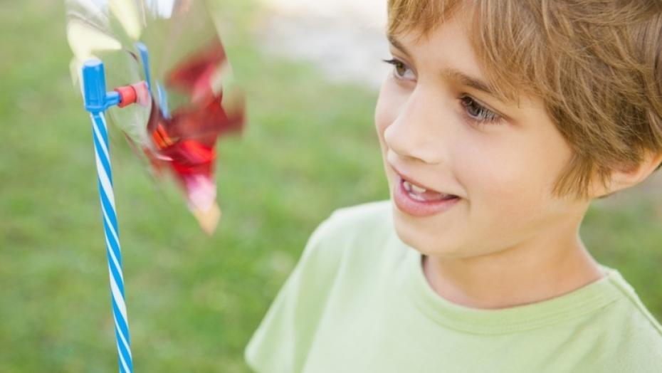 494377945 Boy Looking At Pinwheel