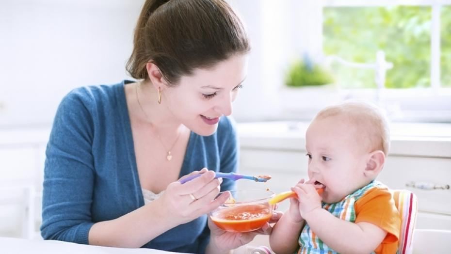 496686167 Baby Boy Eating Solid Food