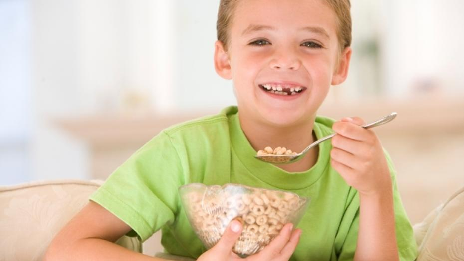 84468409 Boy Eating Cereal