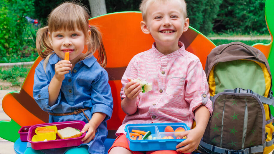 Children eating healthy lunchbox