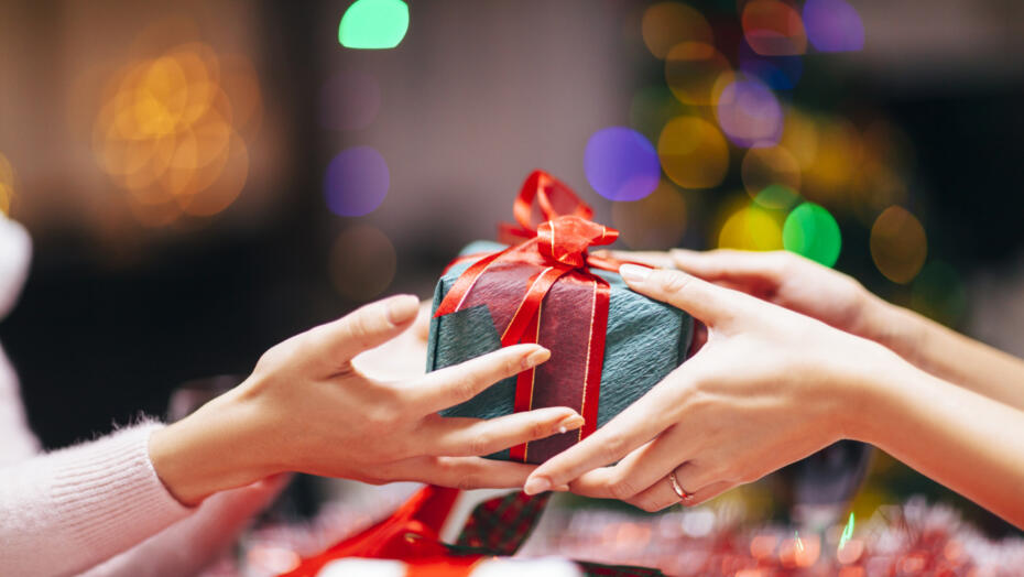 Hands giving holiday gift