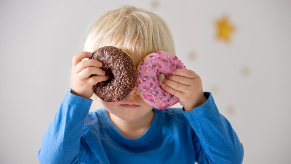 Kid with donuts