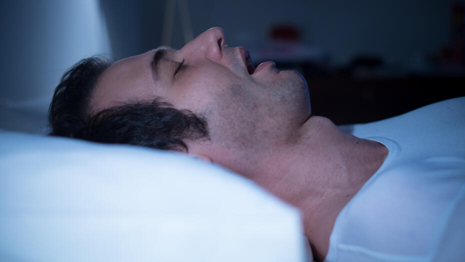 Man sleeping sleep apnea