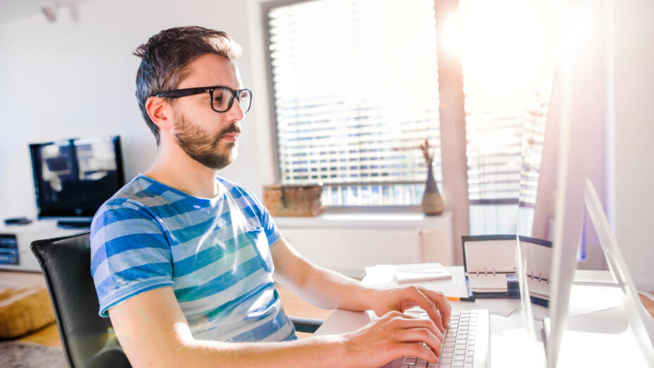 Man with glasses at computer