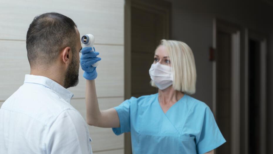Nurse Giving Temperature Scan