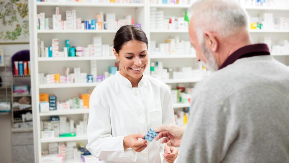 Pharmacist With Man
