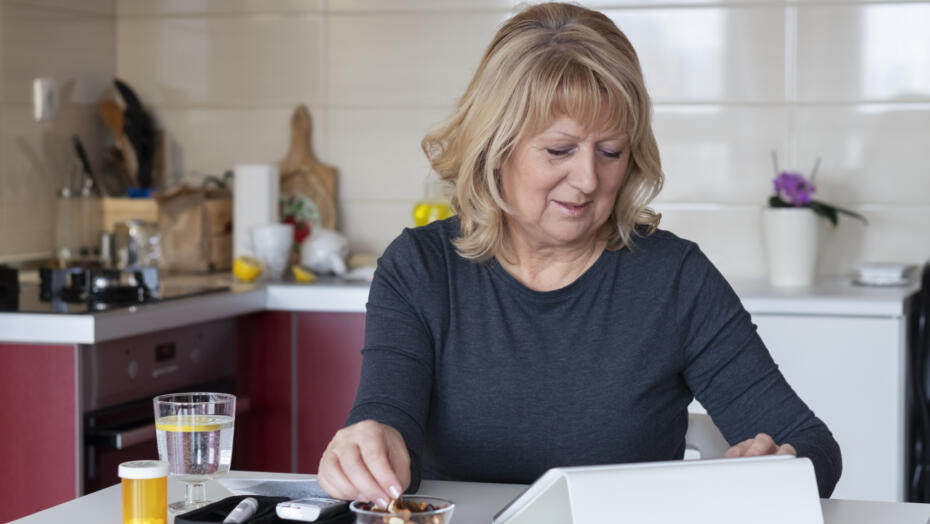 Senior diabetic woman preparing a breakfast at home