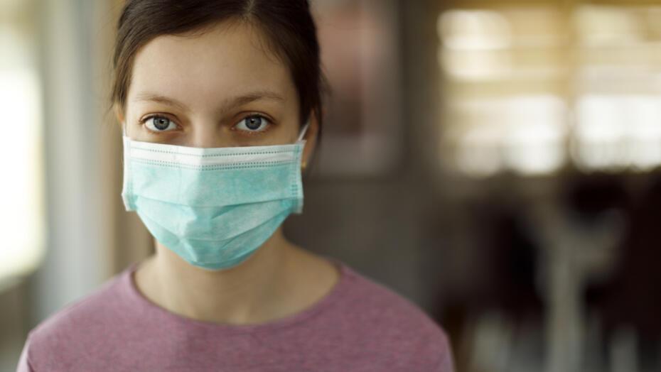 Teenage girl with mask