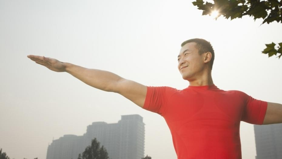 Thinkstockphotos 184565078 Muscular Man Stretching In Park