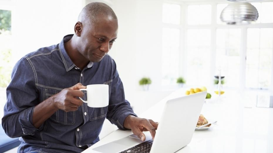 Thinkstock Photos 461259789 man using laptop at home