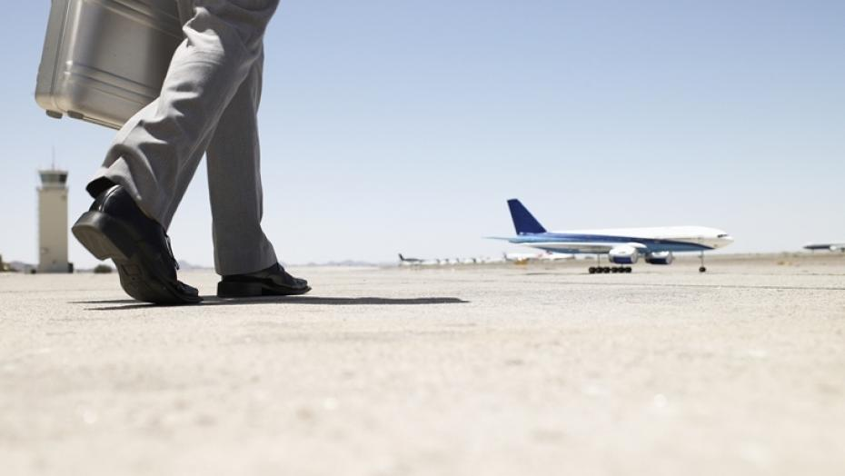 Thinkstockphotos 82186112 Businessman Walking Towards Airplane
