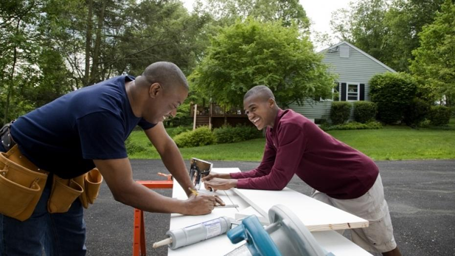 Thinkstockphotos 83590756 Father And Son Working On House