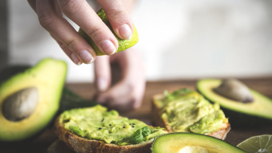 Woman making avocado toast
