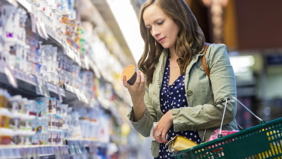 Woman reading yogurt label