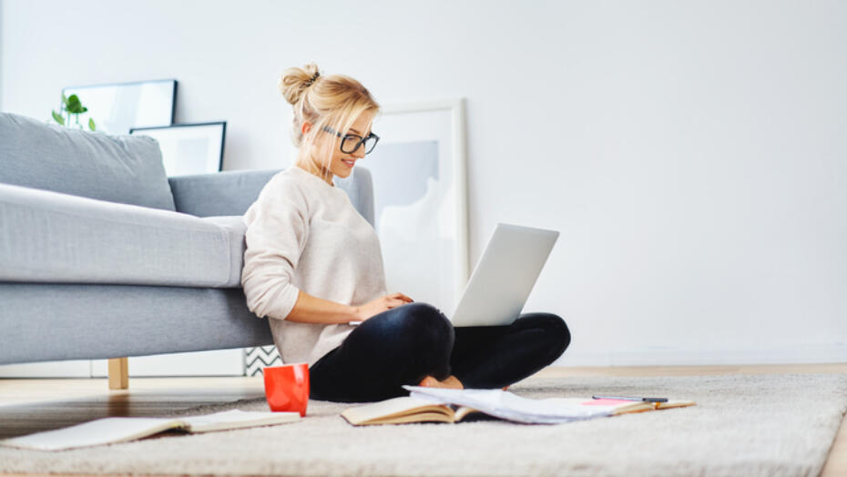 Women wearing glasses doing research on her computer