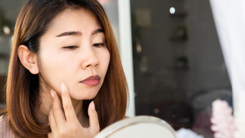Dermal fillers covid 19 vaccine woman looking in mirror
