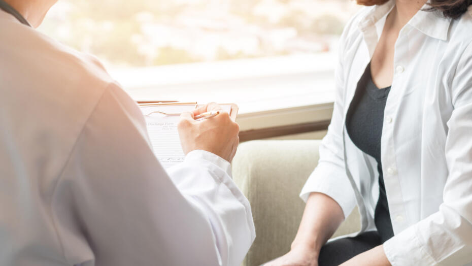 Doctor talking with female patient