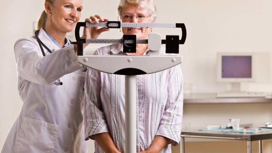 Physician Weighing Patient Scale