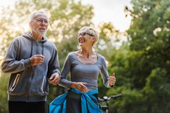Happy older couple exercising