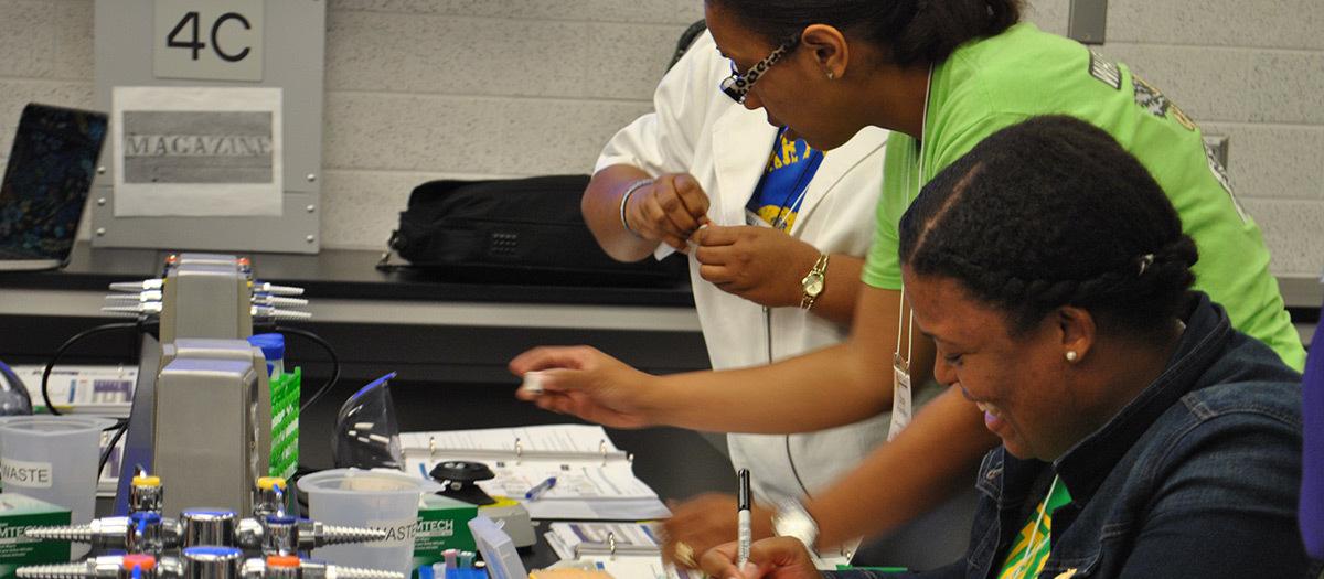 High school teachers work with lab equipment in Ochsner's BEST Science program.