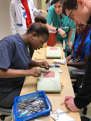 An Ochsner EHealth high school student practices sutures.