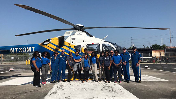 Ochsner EHealth high school students on the helipad.
