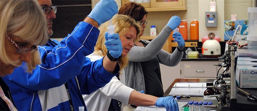 High School teachers perform experiments in Ochsner's BESTScience program.